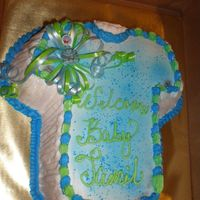 Jamil T Shirt Baby Shower Cake Yellow cake with chocolate filling. Thank you for looking comments are always appreicated. Michelle :-)