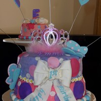 Princess Birthday Party Covered in homemade butter cream icing. Most decorations are fondant. Butterflies, letters, and hearts are gum paste.