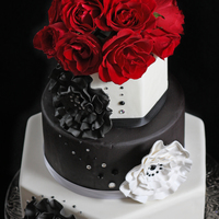 Black And White Wedding Cake Gumpaste decorations with rhinestone accents. Fresh roses on top.Thanks for looking!