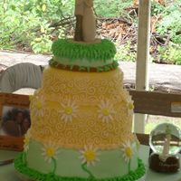Outside Hippie Wedding Cake  This was made for my sister and brother-in-laws wedding. They are both total hippie, and the entire wedding was outside, bare feet and all...