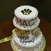 Retirement Cake This is a retirement cake I made for a co-worker who is a police detective and an MU fan. Cake is covered in buttercream; decorations are...