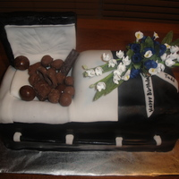 Death By Chocolate Cake This cake was for our local funeral home director, his wife ordered it for his birthday. The lid is styrofoam, and the flowers are silk....