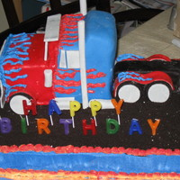 Transformer's Optimus Prime Truck This was for a 5 year old's bday. Crushed oreos as gravel, fondant on the truck, gumpaste for the wheels and truck accessories.