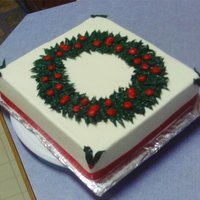 Christmas Wreath Cake Keylime cake with all buttercream icing. Real ribbon around the bottom
