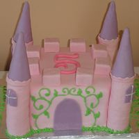 Castle Cake Made for a 5 year old. Rice Krispy Treats for the towers, Ice Cream Cones for the roofs...