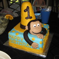 Curious George Cake Got this Idea from a lot of cakes I saw here. The Hat & Georges face are made of RKT covered in Fondant. I wasn't 100% happy with...