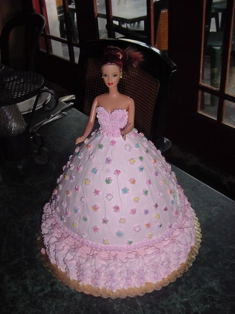 Barbie Doll Cake real Barbie doll in cake, covered in whipped cream