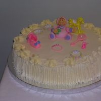 Kathy's Baby Shower Cake cake covered in whipped cream, decorated with edible marzipan baby
