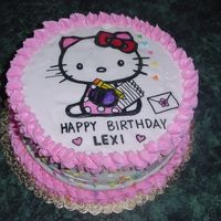 Hello Kitty Cake Cake covered with whipped cream and edible paper picture of Hello Kitty