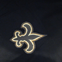 Saints Cake Topper This is a a fleur de lis I made out of chocolate. It was very tricky but it turned out okay,