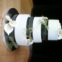 Calla Lily Wedding 10,8,6 BC with gumpaste calla. The black ribbon is a ribbon and the sheer green is tied around the black...she didn't know what she...