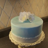 Blue Fantasy Flower This is course 4 final cake. Kept it super simple. Used my fav flower from the course on top- the fantasy flower! No actual cake- just a...