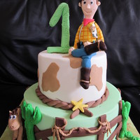 Toy Story - Woody Two tier chocolate mudcake, covered in ganache and coloured fondant. All accents including Woody/Bullseye & 1 and made from fondant.