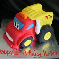 Tonka Truck This is a chocolate mudcake covered in white truffle chocolate and fondant. All edible. I started with an 8inch square cake and carved from...