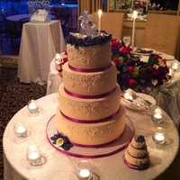 Rose Topped Wedding Cake This wedding cake was created for a very special couple. Not only was it filled with chocolate buttercream but it was also filled with a...