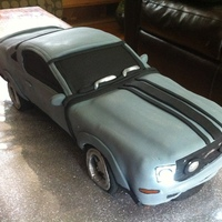 "Car Groom's Cake This groom's cake is a 2011 Mustang. It's 17"" long x 6"" wide x 4"" high. The logo and back lights were handpainted..."