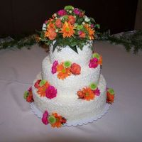 Wedding Cake For My Niece Orange Grand Marinier cake with peach passion fruit filling and buttercream frosting.I helped my neice make this cake. She was so pleased...