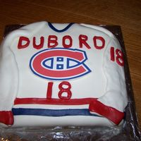 Montreal Canadiens Cake Chocolate cake with buttercream icing and covered in MMF.