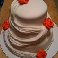 My First Attempt At A Wedding Cake This cake was made for a mock wedding that I had to do for a group project at school. I'm still learning how to make proper roses. I...