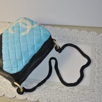 Chanel Purse I made this cake for a friend who loves purses. Made with Jen Dontz's fondant recipe.