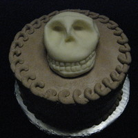 Skull Cake This cake was for a little boy's birthday. He said he wanted a skull cake (this one is white chocolate candy clay).