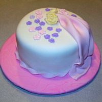 My First Fondant Cake  This is my first fondant cake:) I am taking the Wilton Fondant Gumpaste course, and am having a blast!!! The little flowers are leftovers I...