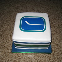 Vancouver Canucks Lemon cake with raspberry SMBC. Edible image photo on the top. Fondant stripes on the side.