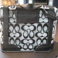 Coach Purse Cake This is a cake I did for my girlfriend's 40th birthday. I was very worried about it since it was my first carved cake and the first...