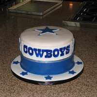 Dallas Cowboys Chocolate cake with peanut butter SMBC filling, covered in fondant. Had some issues with the airbrushing. Had to leave some pieces to...