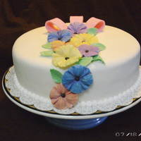 "Hibiscus These flowers were made from a mold I got at the Florida ICES Day of Sharing in Feb 2010. The cake is a 10"" round covered in..."