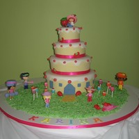 Strawberry Shortcake Birthday cake for a two yr. old, ribbon trim. Client provided the figurines.