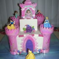 Disney Princess Castle Cake This cake was made with a castle kit that I bought on e-bay. I made the flowers out of cold porcelain that way I could have a keepsake of...