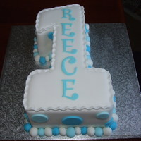 1St Birthday Cake Number 1 shaped cake with fondant Icing balls