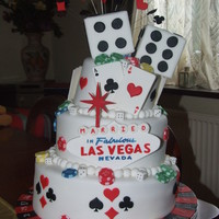 Vegas Wedding Inspired by a couple of cakes I found on here. This cake was made for my friend who had just got married in Vegas.