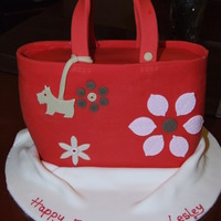"Radley Handbag Made from standing an 8 x 10"" Oblong cake on its end and carving to make the bag shape. Covered in red fondant and decorated with..."