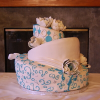 Topsy Turvy Teal This was my first wedding cake, my first three tier topsy turvy, only my second ever topsy turvy, first draping, and first peonies. SO MUCH...