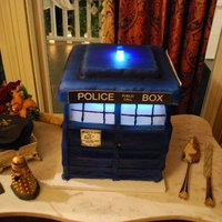 Tardis TARDIS (from Dr. Who) Groom's cake. Chocolate cake with Jameson chocolate ganache. Electrically lit in two places, which was a...