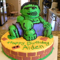 Hulk I saw one of these on CC... I am not very good at carving or piping but the 5 year old liked the cake :)