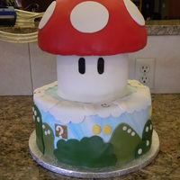 Mario's Mushroom  This cake is not a very good copy of another CCer's cake, but my sister's boyfriend LOVES everything Mario so I had to try my...