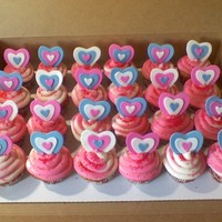 Valentine's Day Cupcakes   strawberry cupcakes with strawberry cream filling and cream cheese frosting. with MMF hearts