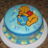 Winnie The Pooh  Made this cake for a friends nephew for his 1st bday..all MMF accents..pooh body, red shirt, &blue honey pot are MMF accents..the rest...