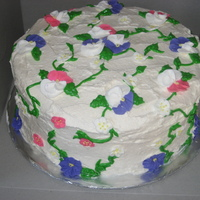 Mothers Day whipped cream frosting with simple royal icing flowers and vines