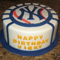 Yankees Birthday Cake for my cousins birthday. i had a difficult time with the stiches on the baseball,,but i think i did ok for freehanding it