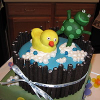"Frog & Duckie Baby Shower Cake Top tier is chocolate cake with strawberry buttercream filling and vanilla buttercream icing. Covered with fondant, sides are ""Oreo..."