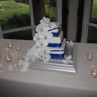 Gran & Jenna's Wedding Jenna & Grant's Wedding! Top tier chocolate Middle tier vanilla bean Bottom tier lemon All topped with vanilla buttercream. Satin...