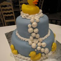 Rubber Ducky... French vanilla cake, cherry filling, buttercream, topped with fondant. Bubbles are royal icing, rolled in luster dust. The duckies along...