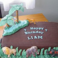 Animal Safari Cake chocolate fondant covered cake, with chocolate animals. Everthing is edible even the palms.