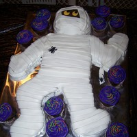 Mummy I have done Mummy cakes before of just the head, but decided to do the whole body this year. Just chocolate cake with MMF and a few...