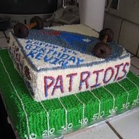 New England Patriots Skateboard i did this cake for my nephew 9 th birthday,he likes the patriots and skateboarding.
