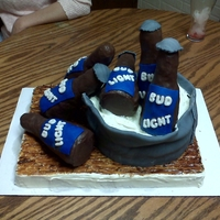 Beer Bottle Cake This was for a birthday. It was all edible. The beer bottles are made out of rice crispies and covered in molding chocolate (I couldn'...